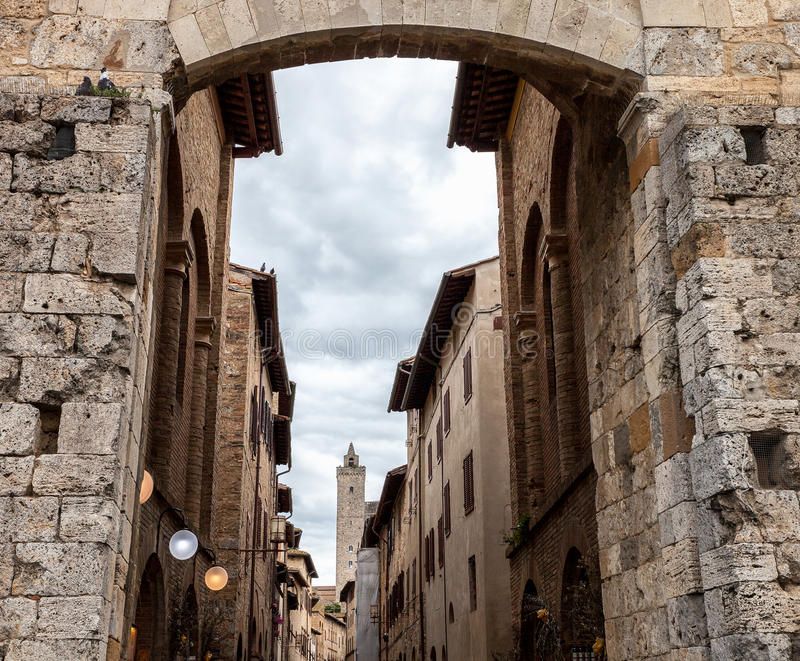 View from the arch at the entrance to the San Gimignano, Italy stock photo
