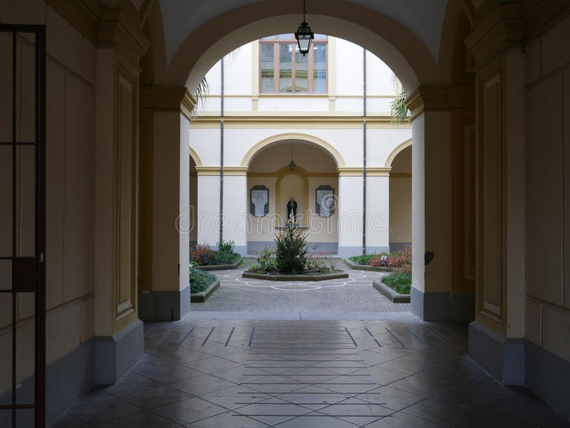 View through an arch of a formal courtyard stock images