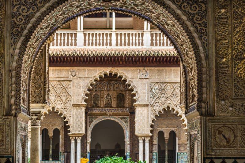 View through an arch of Patio de las Doncellas stock image