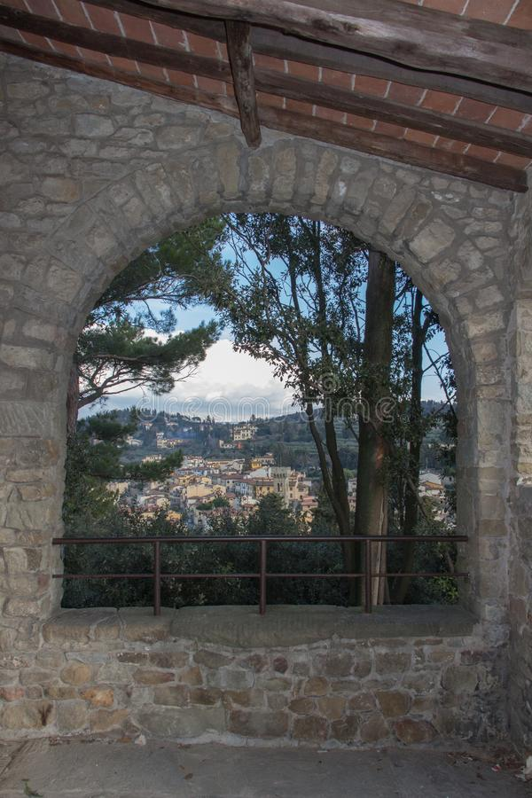 The view through an arch of San Francesco Monastery in Fiesole, Tuscany, Italy royalty free stock photos