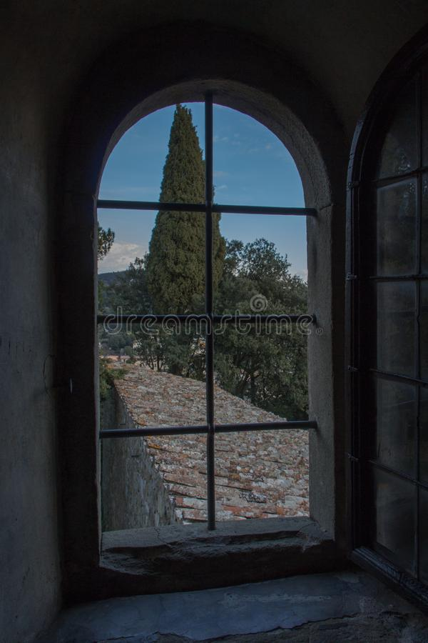 View from an arch window on Tuscany landscape, Italy royalty free stock photography