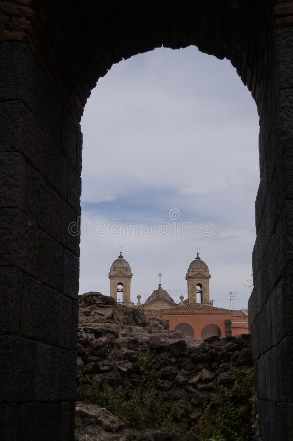 View from the arched window to the historical sights of Catania. Italy. Historical attraction.View from the arched window to the historical sights of Catania royalty free stock photos