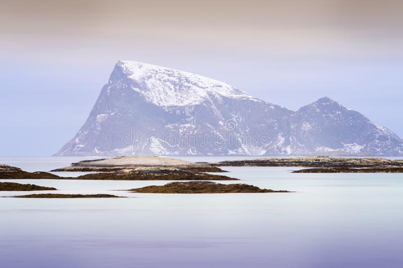 View of Arctic bay in Norway during Polar night. With snowcovered mountains in background, Somoya, Norway stock images
