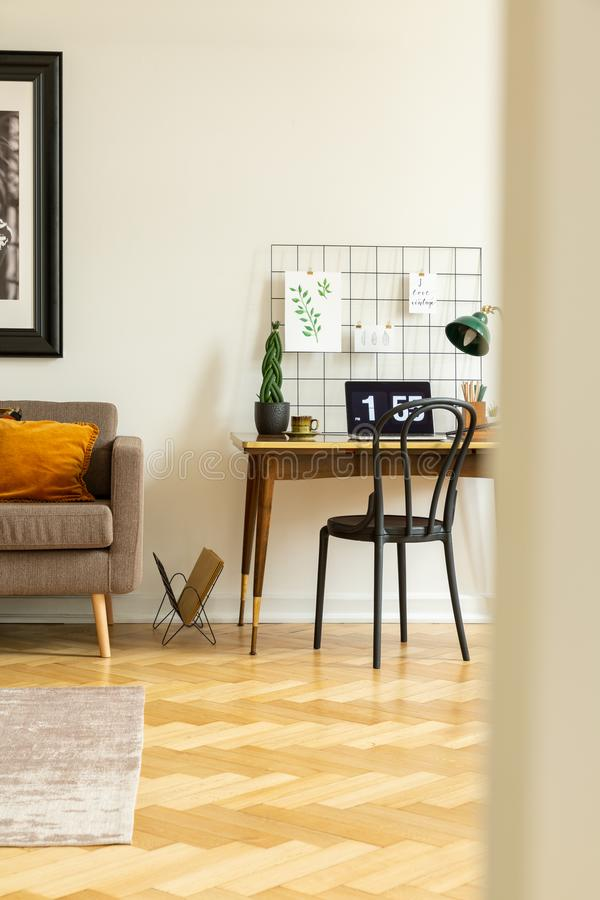 View from around the corner into a classic home office interior with elegant wooden furniture and herringbone parquet floor. Concept royalty free stock image