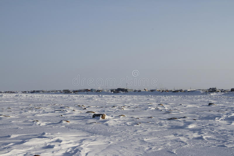 View of Arviat, Nunavut with snow landscape. Near Hudson Bay royalty free stock photo