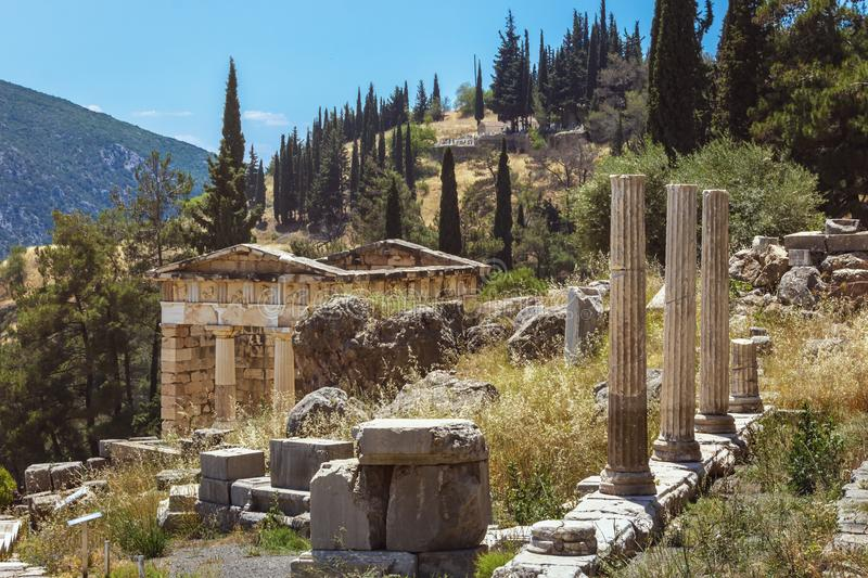 The Athenian Treasury - Delphi - Greece. The view of the Athenian Treasury with the columns in Delphi royalty free stock image