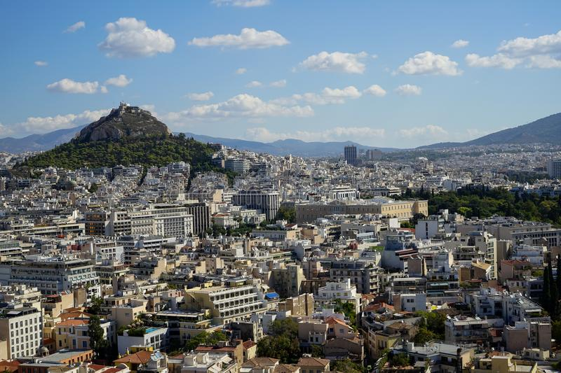 View of Athens city from Acropolis seeing white buildings architecture, Mount Lycabettus, mountain, blue sky and white cloud royalty free stock images