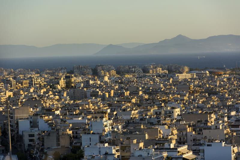 view of Athens and the Saronic Gulf from above, Greece sunset over the city, royalty free stock photography