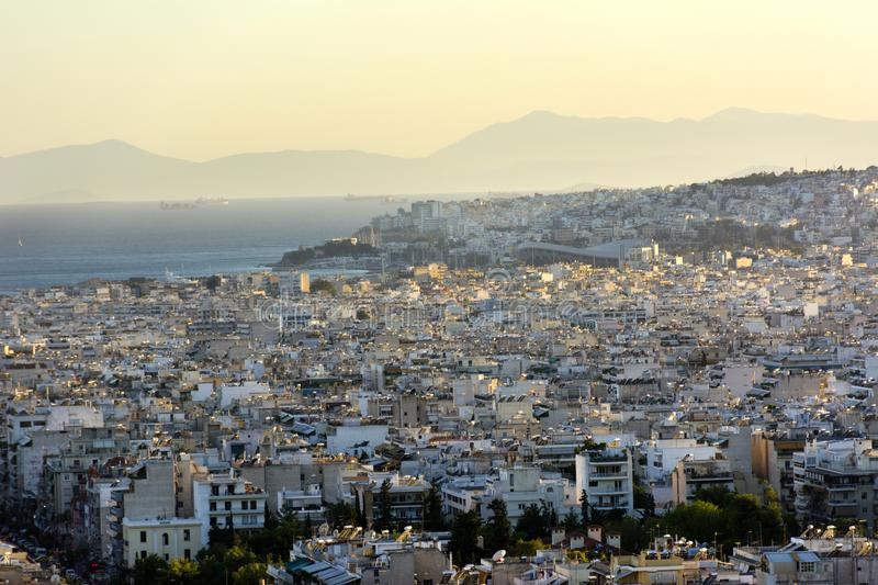 View of Athens and the Saronic Gulf from above, sunset over the stock photography