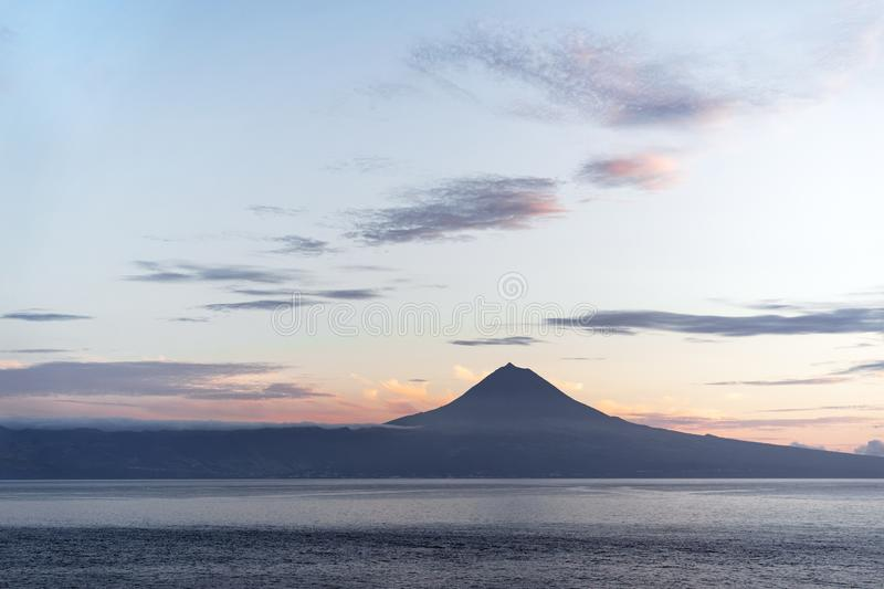 Azores - View over water to the volcano Pico in the evening light. View from the Azores island Sao Jorge to the island Pico with the volcano `Ponta do Pico`, the royalty free stock images