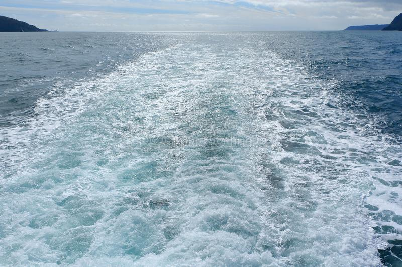 Cruise ship`s wake with water foam and wave. View from the back of cruise ship, wake with wave and water foam stock images