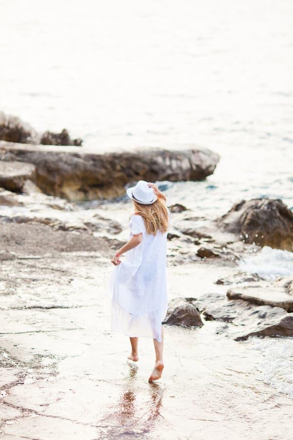 Towards a new life walking on the beach royalty free stock photo