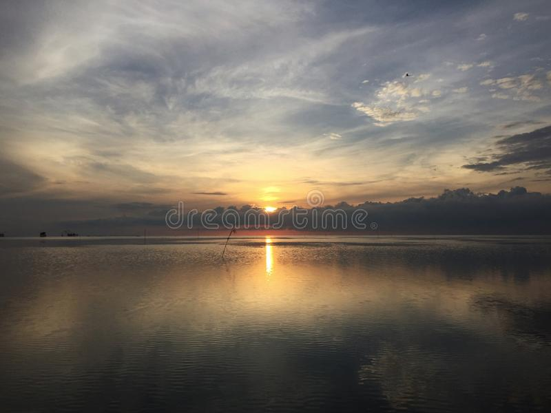 View background of sunrise reflection on the lake with the calm of water stock photos