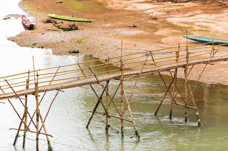 View of the bamboo bridge on the river Nam Khan, Luang Prabang, L. Aos. Copy space for text stock images