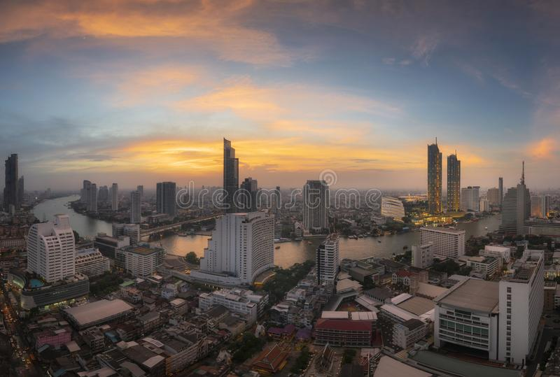 View of Bangkok modern office buildings with Chaophraya river in sunset royalty free stock image