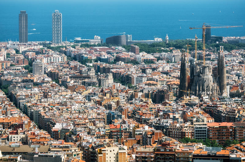 View of Barcelona, the Mediterranean sea, Sagrada Familia, Catalonia, Spain. Aerial view of Barcelona, the Mediterranean sea, Sagrada Familia and The twin royalty free stock photography