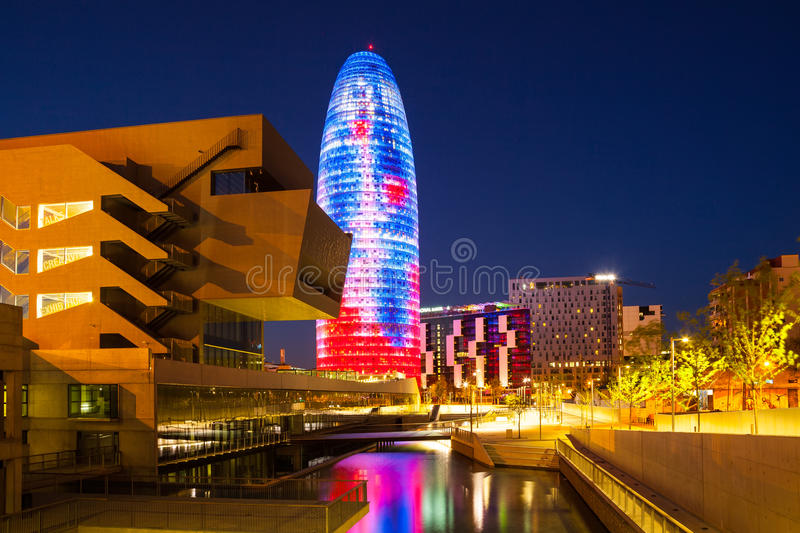 View of Barcelona, Torre agbar skyscraper in night. BARCELONA, SPAIN - APRIL 12: Torre agbar skyscraper in night in April 12, 2013 in Barcelona, Spain. 38 storey royalty free stock photography