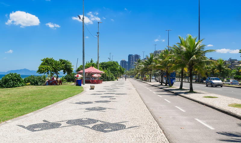View Barra da Tijuca with palms and mosaic of sidewalk in Rio de Janeiro. Brazil stock images