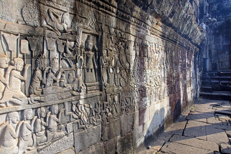 View bas-reliefs on the walls of the temple of Bayon stock image
