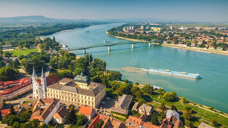 View from the basilica in Esztergom. View of the Hungarian historic town from the basilica in Esztergom, the Danube river and the border bridge to the town of stock photos