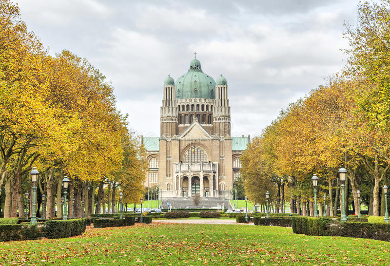 View on Basilica of Sacred Heart from Elisabeth Park. With yellow thees, Brussels, Belgium royalty free stock photography