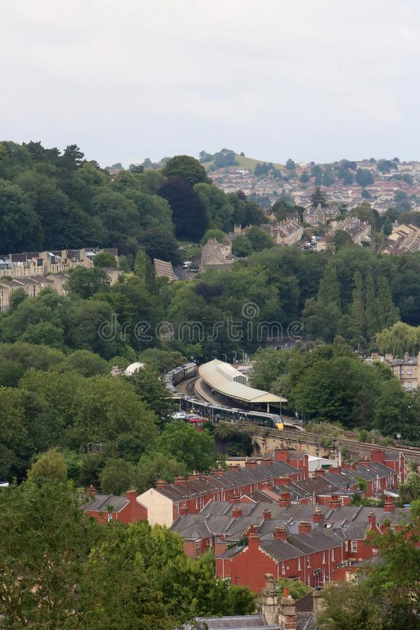 View over suburbs to Bath Spa station and train royalty free stock photo