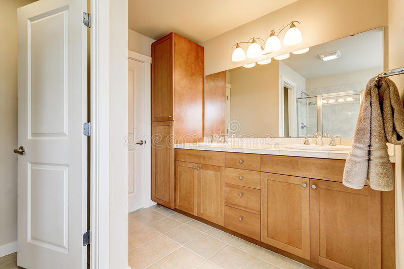 View of bathroom storage units, two sinks and large mirror. House interior. Northwest, USA royalty free stock image