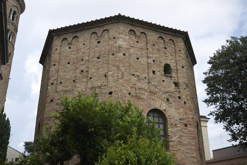 View of Battistero Neoniano exterior. Ravenna, Italy - August 14, 2019 : View of Battistero Neoniano exterior royalty free stock photography