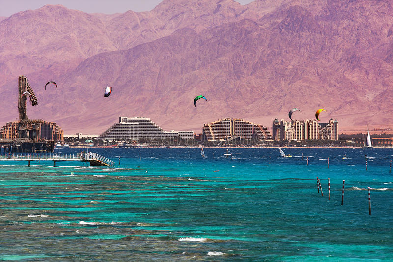 View on bay and coastline in Eilat, Israel. View on coastline with hotels, mountains and bay of Eilat located on Red Sea in Israel stock photo