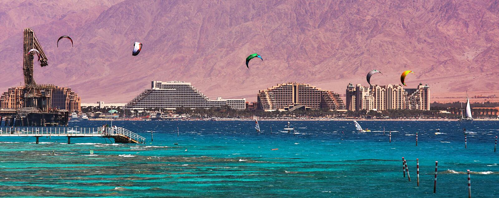 View on bay and coastline in Eilat, Israel. Panoramic view on coastline with hotels, mountains and bay of Eilat located on Red Sea in Israel royalty free stock photo