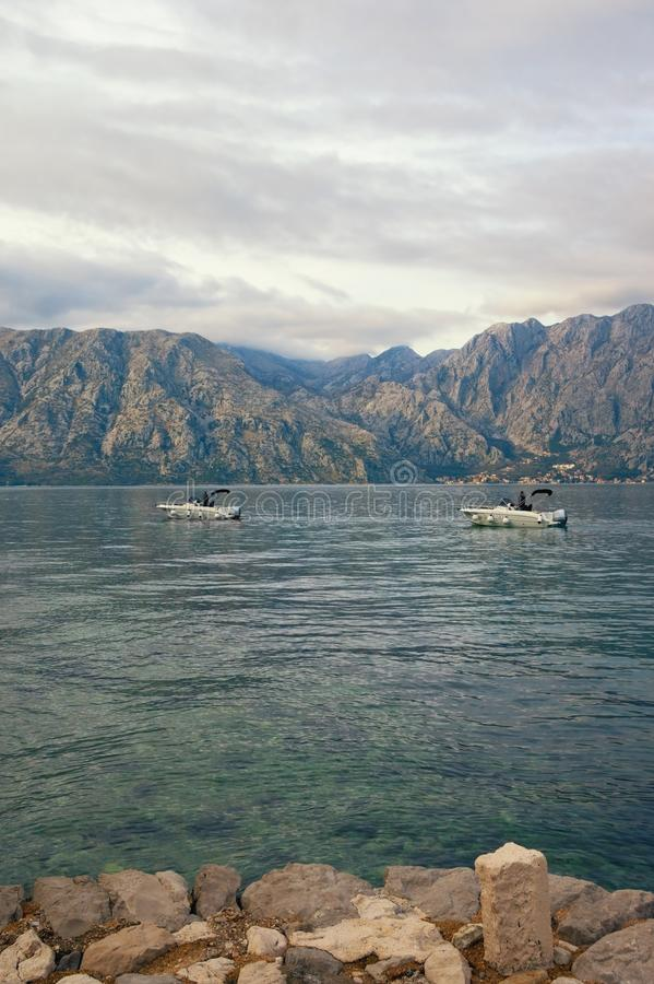 View of Bay of Kotor near Prcanj town on cloudy day. Montenegro, Adriatic Sea royalty free stock photo