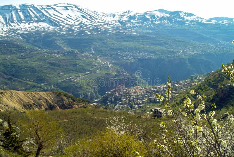The beautiful mountain town of Bcharre in Lebanon. A view of Bcharre, a town in Lebanon high in the mountains on the edge of the Qadisha Gorge. Religious stock photo