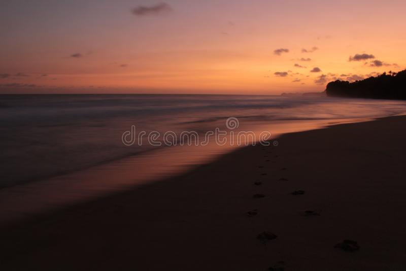 Views of the beach in the afternoon with colorful skies. View of the beach in the afternoon with colorful skies. with a smooth view of the waves stock photography