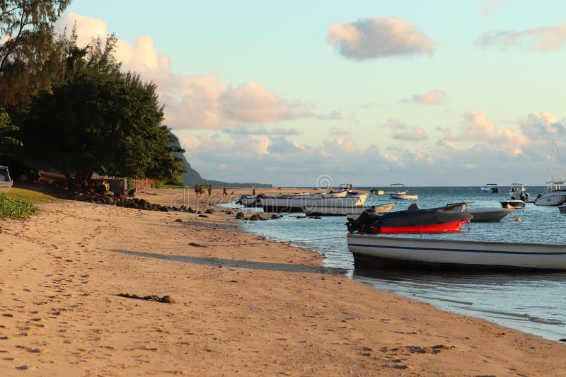 View of the beach with boats on Mauritius island. royalty free stock image