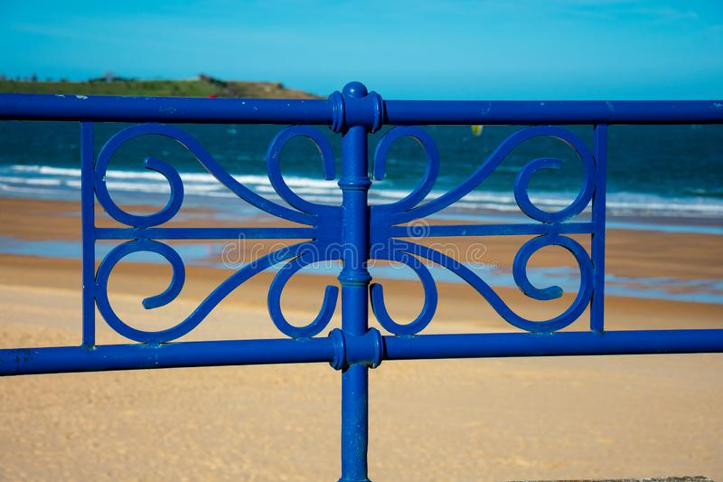 View of the beach and Cantabrian Sea Mar Cantabrico. Behind the fence royalty free stock image