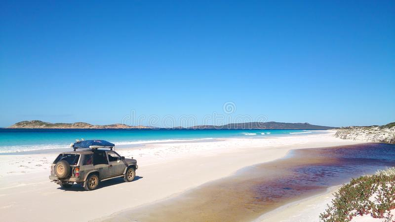 View of Beach on Fraser Island with one car. Beautiful stunning view of 75 Mile Beach on Fraser Island, Queensland, Australia, located in the Great Sandy royalty free stock images