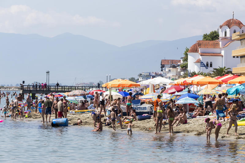View of the beach of Katerini in Greece. People enjoy the fresh. Katerini, Greece- July 7, 2015: View of the beach of Katerini in Greece. People enjoy the royalty free stock images