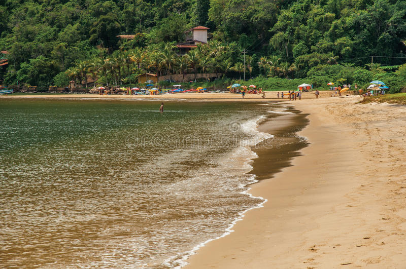 View of beach, sea, forest and people in Paraty Mirim. royalty free stock images