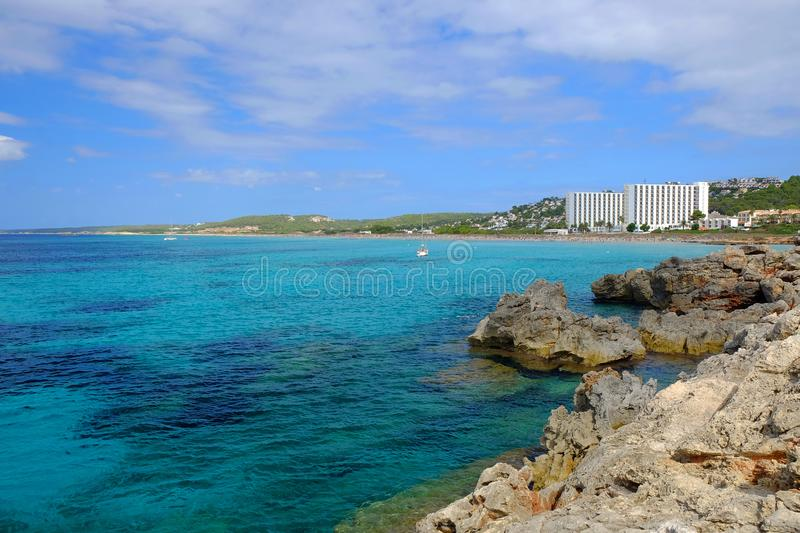 View on the beach Son Bou and white boat on the Balearic Island Menorca, Spain royalty free stock photography