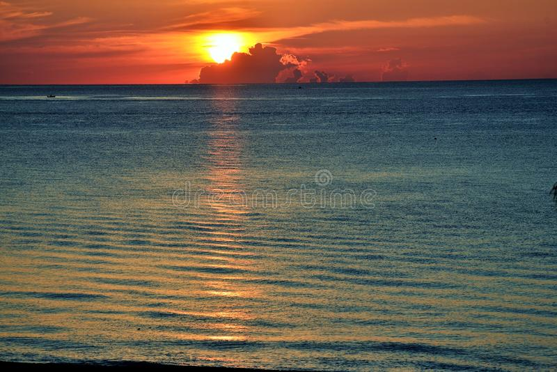 View from the beach of sunrise with cloud cover stock image