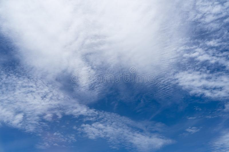 View of beautiful abstract splash soft white cloudscape with shades of bright blue sky background from flying plane window royalty free stock photos