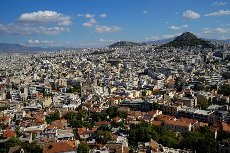 View of beautiful Athens cityscape from Acropolis seeing lowrise building architecture, Mount Lycabettus, mountain, blue sky royalty free stock image