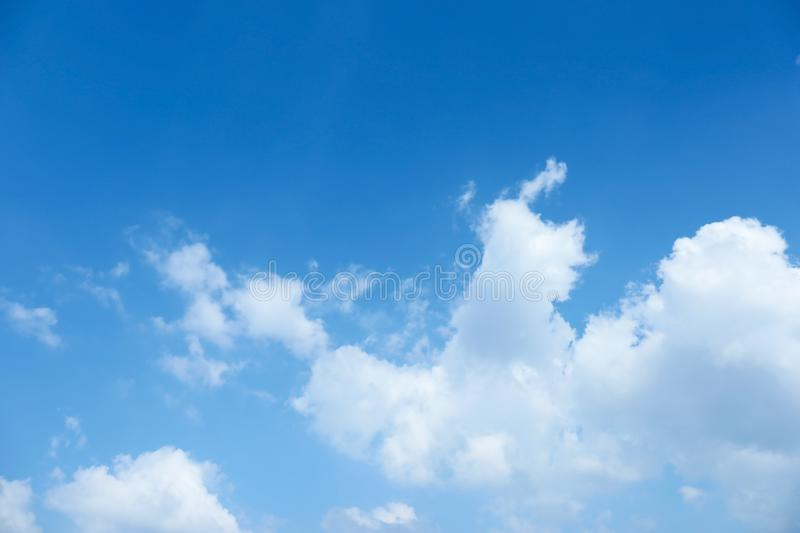 View of beautiful blue sky. With fluffy clouds royalty free stock images