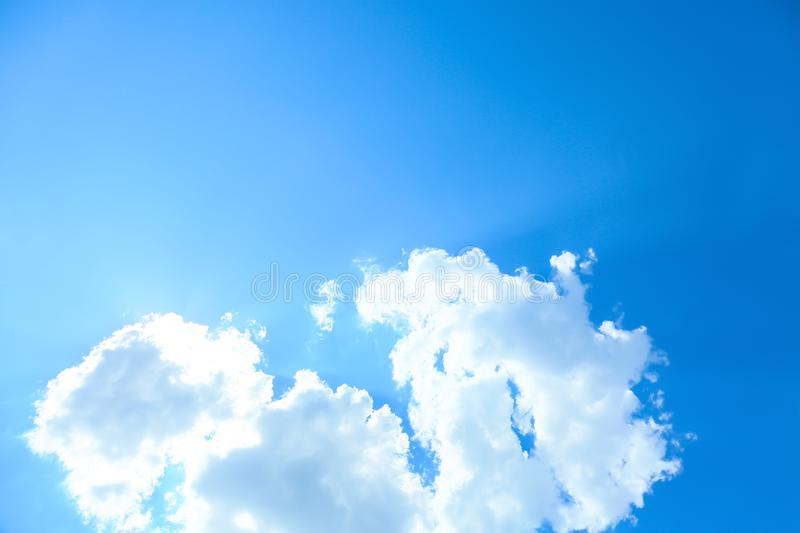 View of beautiful blue sky with fluffy clouds stock photo