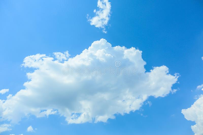 View of beautiful blue sky with fluffy clouds stock photography