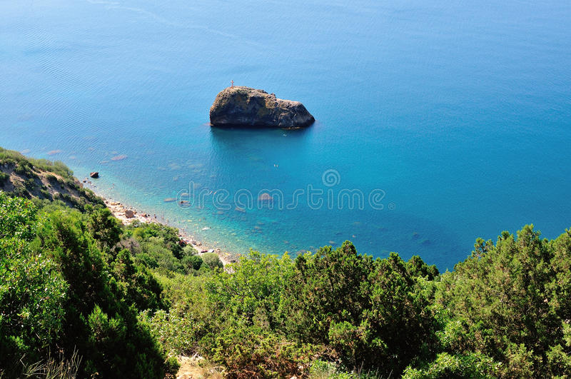 View of beautiful cape in Crimea. National Park Cape Fiolent bathed by the crystal blue water royalty free stock images