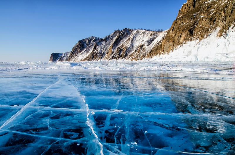 View of beautiful drawings on ice from cracks and bubbles of deep gas on surface of Baikal lake in winter, Russia. View of beautiful drawings on ice from cracks stock photo