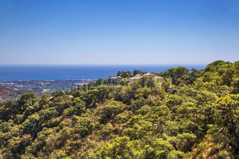 View of a beautiful hillside with the sea and mountains royalty free stock photography