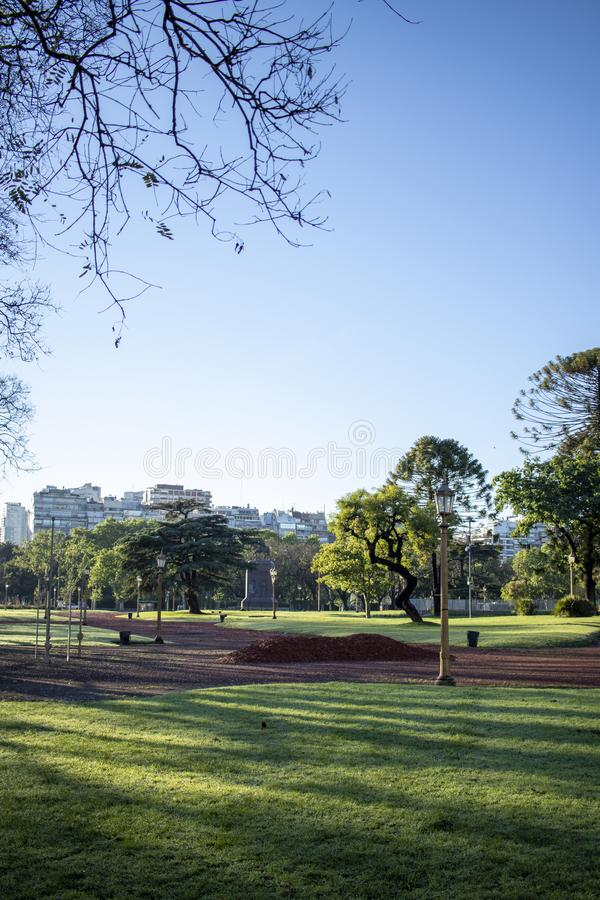 Beautiful park with green areas and reddish soil, located within the city. View of a beautiful park with green areas and reddish soil, located within the city stock images