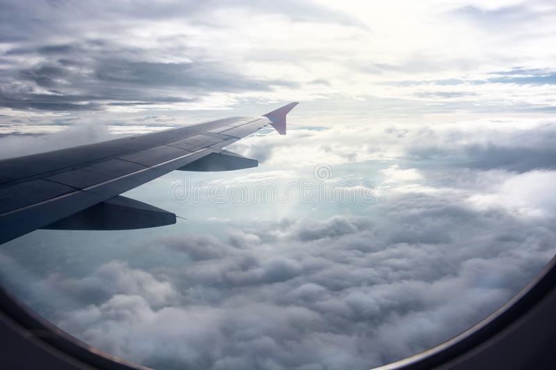 View of beautiful raincloud and wing of airplane from window, vi royalty free stock photography